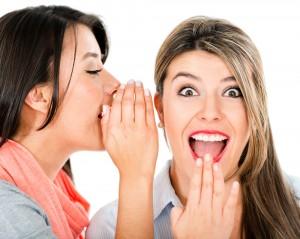 Two Women Sharing a Secret