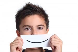 kid afraid to smile