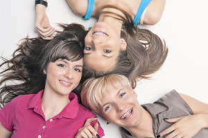 Three Young Women with BRaces Have Reasons to Smile