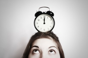 Woman watching the clock waiting for Invisalign
