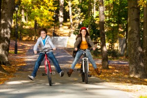 kids riding bikes in the park